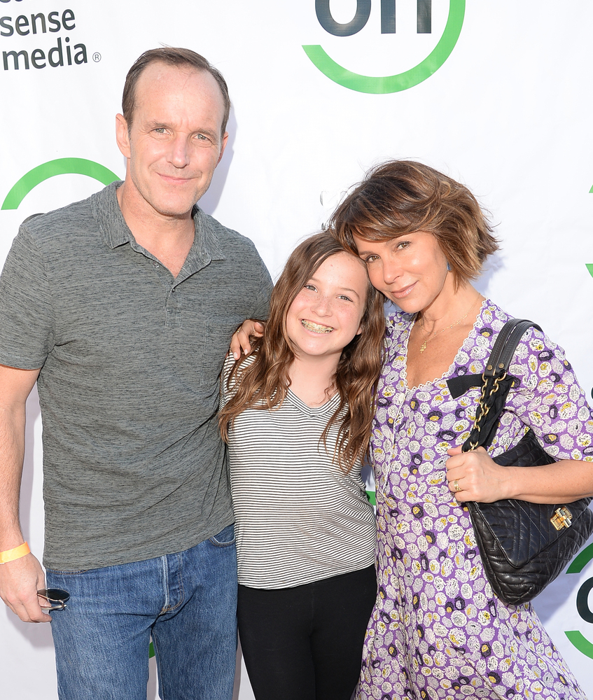 Actor Clark Gregg, daughter Stella Gregg, and actress Jennifer Grey attend the 2nd Annual GameOn! fundraiser hosted by Common