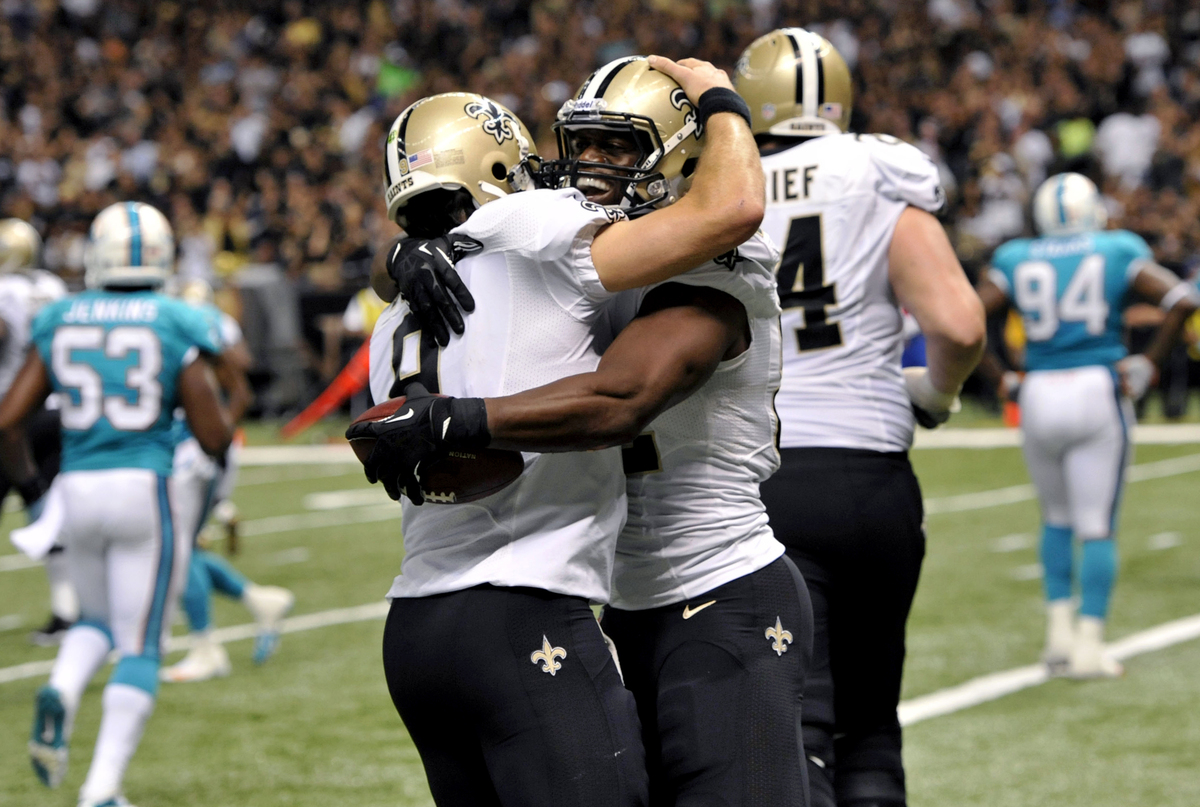 New Orleans Saints tight end Benjamin Watson celebrates his touchdown reception with quarterback Drew Brees (9) in the second
