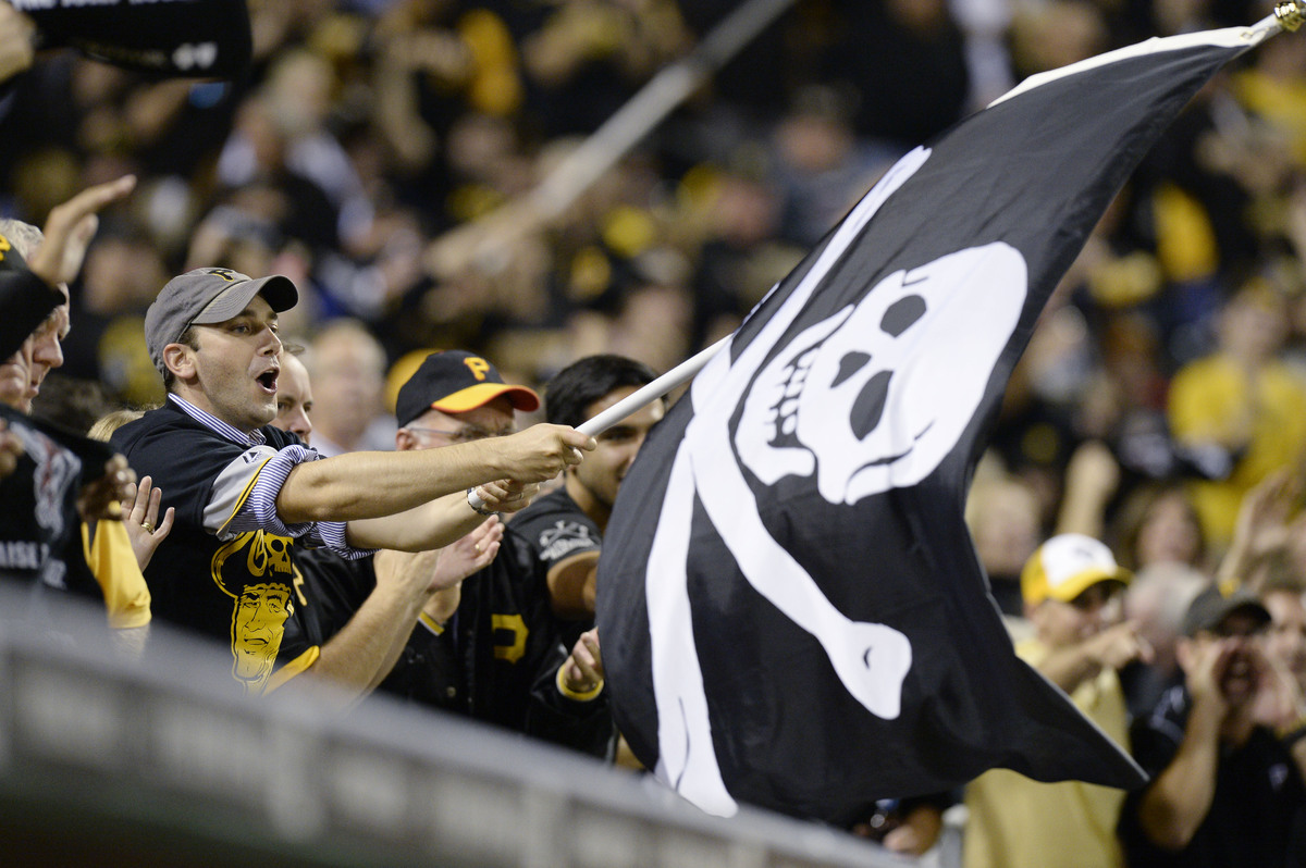 A Pittsburgh Pirates fan waves a Jolly Roger flag as the Pirates play the Cincinnati Reds in the NL wild-card playoff basebal