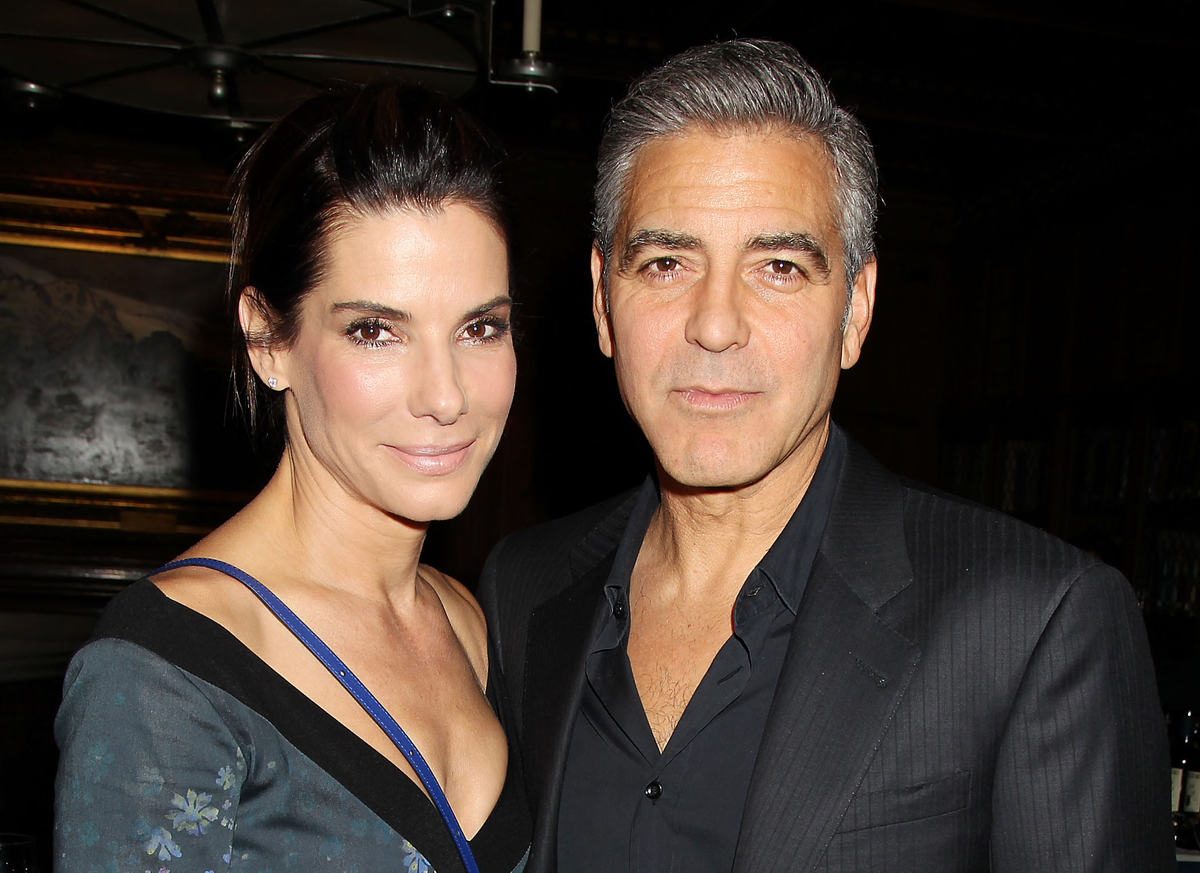 "This image released by Starpix shows Sandra Bullock, left, and George Clooney at luncheon honoring the film ""Gravity,"" and ho"