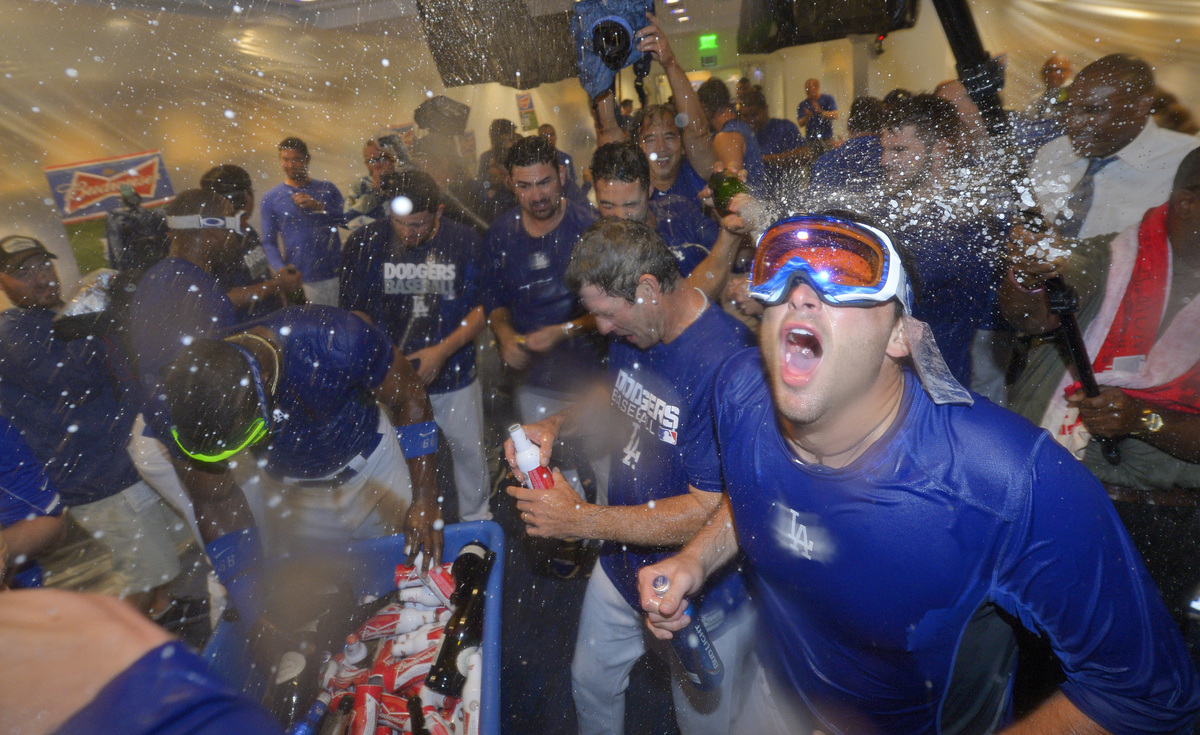 Los Angeles Dodgers players celebrate in the clubhouse after they defeated the Atlanta Braves 4-3 in Game 4 of the National L