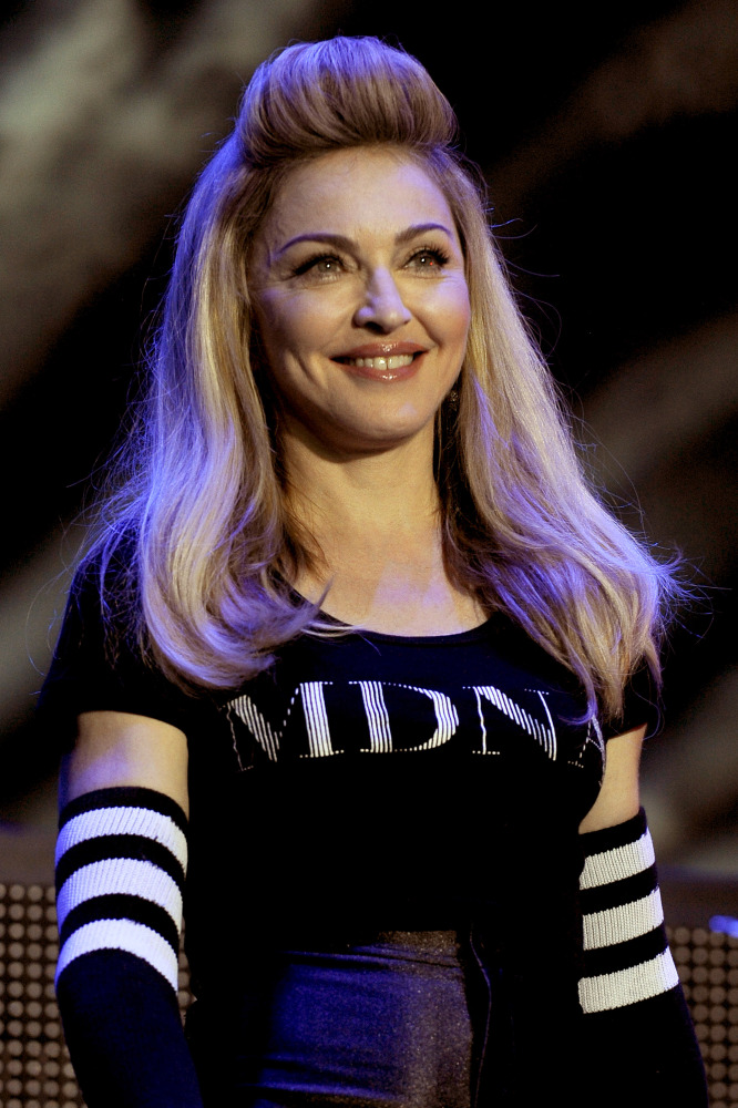 """Madonna was raised Catholic but embraced Kabbalah in the mid 1990s after being <a href=""""http://www.youtube.com/watch?v=MhoM9x"""
