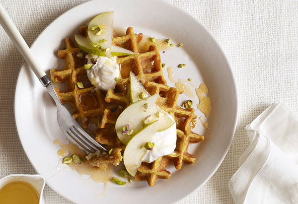 Waffle batter fortified with pumpkin puree makes for just a little bit richer and sweeter way to start your day. Make a batch