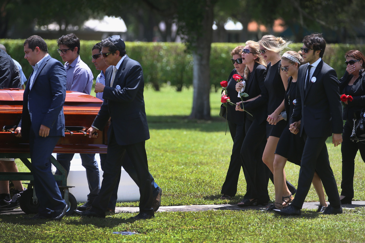 MIAMI LAKES, FL - AUGUST 14:  Jacqueline Llach (2nd L) the mother of 18-year-old graffiti artist Israel Hernandez-Llach, walk