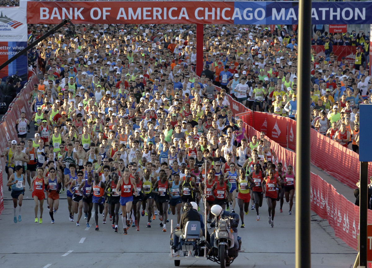 Runners start the Chicago Marathon in Chicago, Sunday, Oct. 13, 2013, nearly six months after the Boston Marathon bombings, w