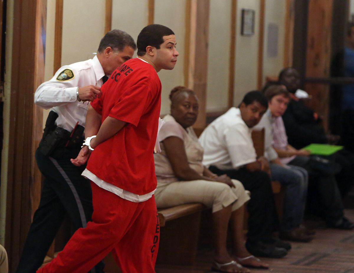 Eric Rivera Jr. is moved through the hallway to the courtroom holding room on Friday, Nov. 1, 2013, during the third day of d