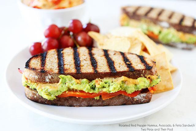"<strong>Get the <a href=""http://www.twopeasandtheirpod.com/roasted-red-pepper-hummus-avocado-feta-sandwich/"" target=""_blank"">"