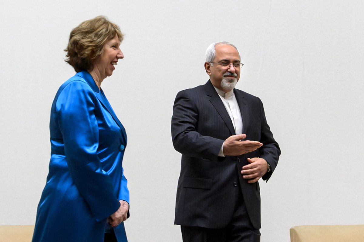 EU High Representative for Foreign Affairs Catherine Ashton, left, walks next to Iranian Foreign Minister Mohammad Javad Zari