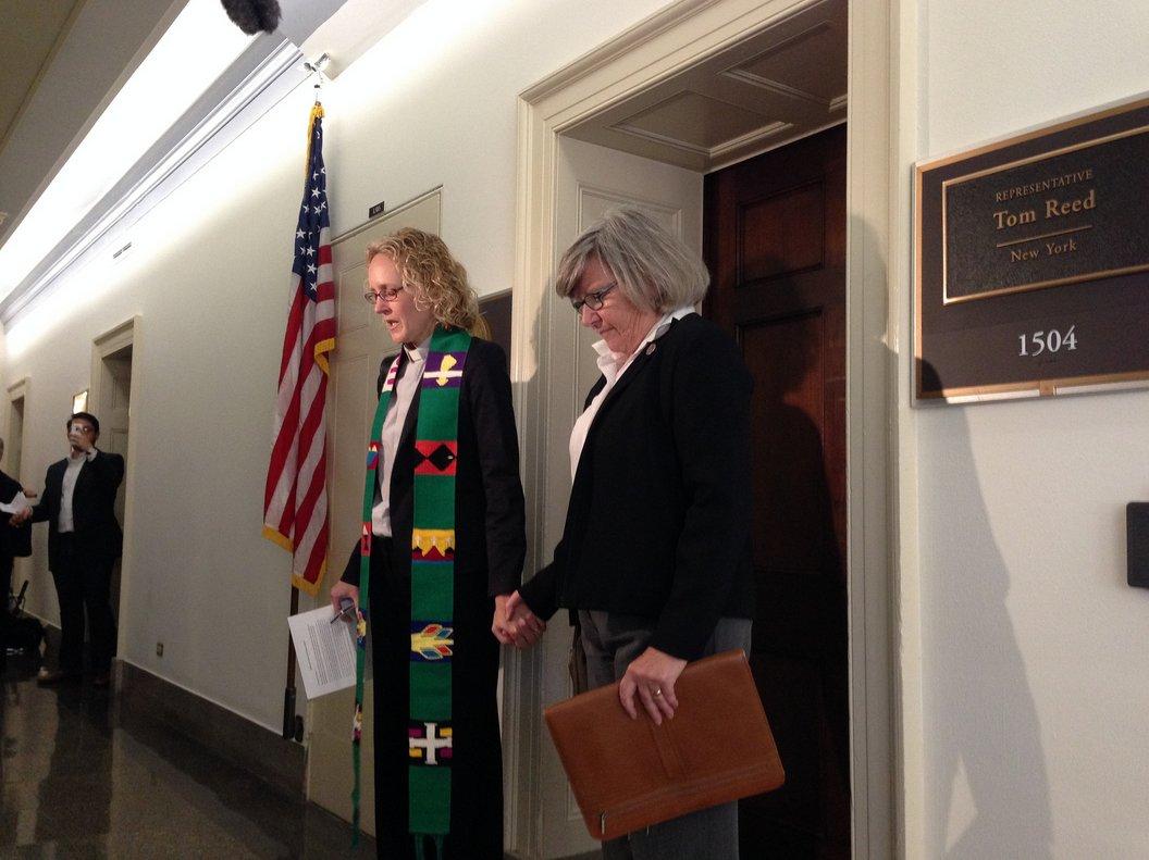 Rev. Jen Butler & Sister Simone Campbell lead us in prayer outside Rep. Tom Reed's office