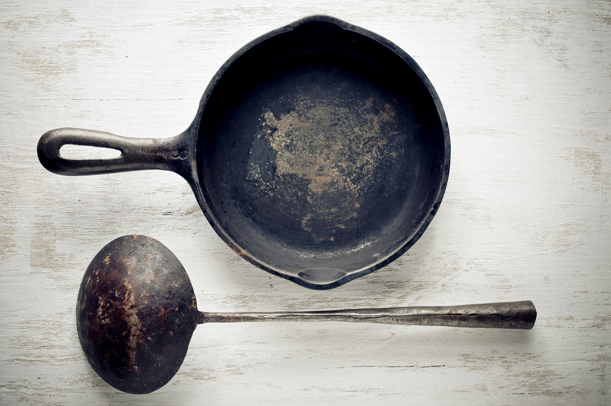 Okay, the cast iron skillet pictured is probably about 100 years old, but we're trying to <em>scare you straight, here</em>.
