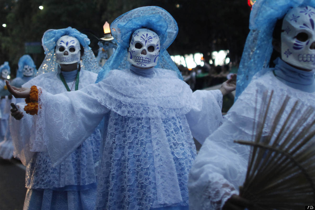 "Women wear masks representing ""La Catrina"" during the bicentennial parade in Mexico City, Wednesday Sept. 15, 2010. Mexico ce"
