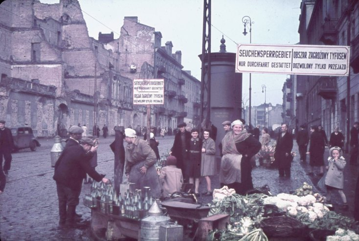 "Warsaw, Nazi-occupied Poland, 1940. The signs read, ""Typhus area. Passage permitted only while traveling."""