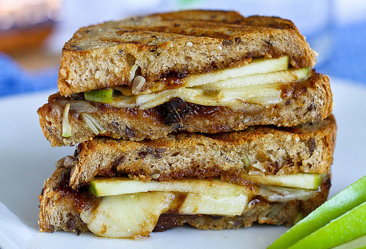 """<strong>Get the <a href=""""http://www.cookincanuck.com/2013/09/gruyere-apples-fig-panini-recipe-cookbook-giveaway/"""" target=""""_bl"""