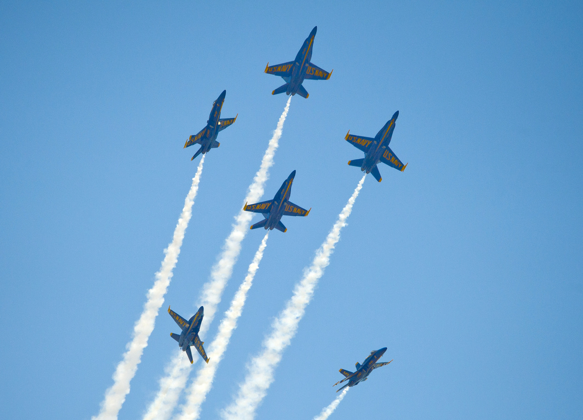 In this photo provided by the Florida Keys News Bureau, the U.S. Navy's Blue Angels perform their precision aerobatics over t