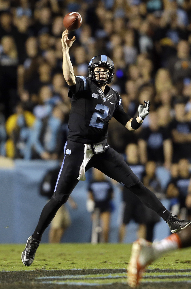North Carolina quarterback Bryn Renner (2) passes against Miami during the first half of an NCAA college football game in Cha