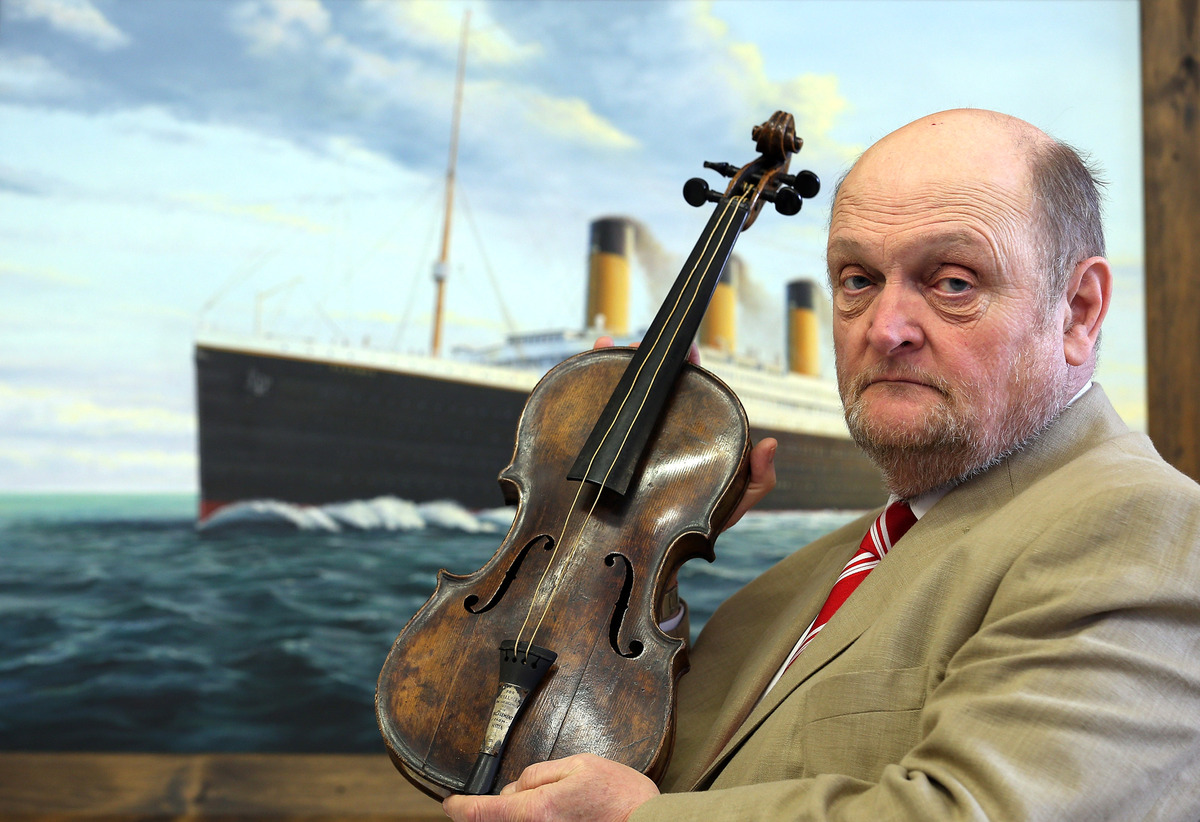 Auctioneer Alan Aldridge of auctioneers Henry Aldridge & son holds the violin of Wallace Hartley, the instrument he played as