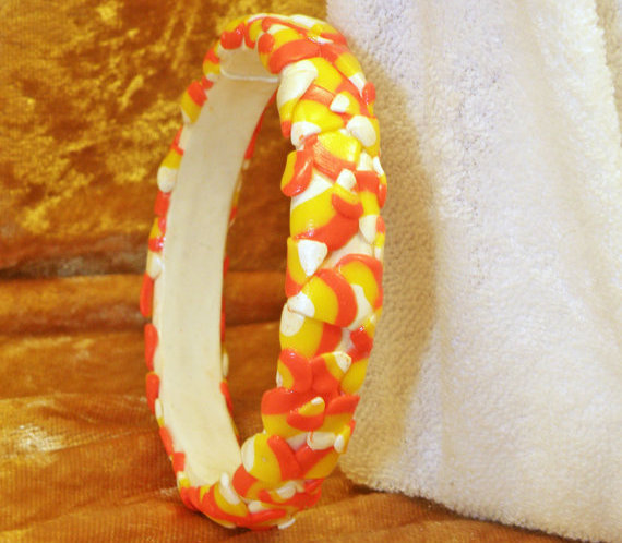 "<em><a href=""https://www.etsy.com/listing/82556142/halloween-bracelet-expanding-candy-corn?ref=sr_gallery_18&ga_search_query="