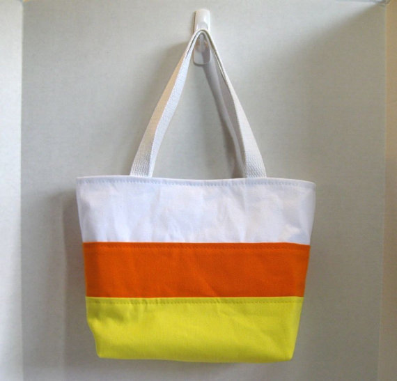 "<em><a href=""https://www.etsy.com/listing/58444937/candy-corn-purse-halloween-tote-ready-to?ref=sr_gallery_16&ga_search_query"