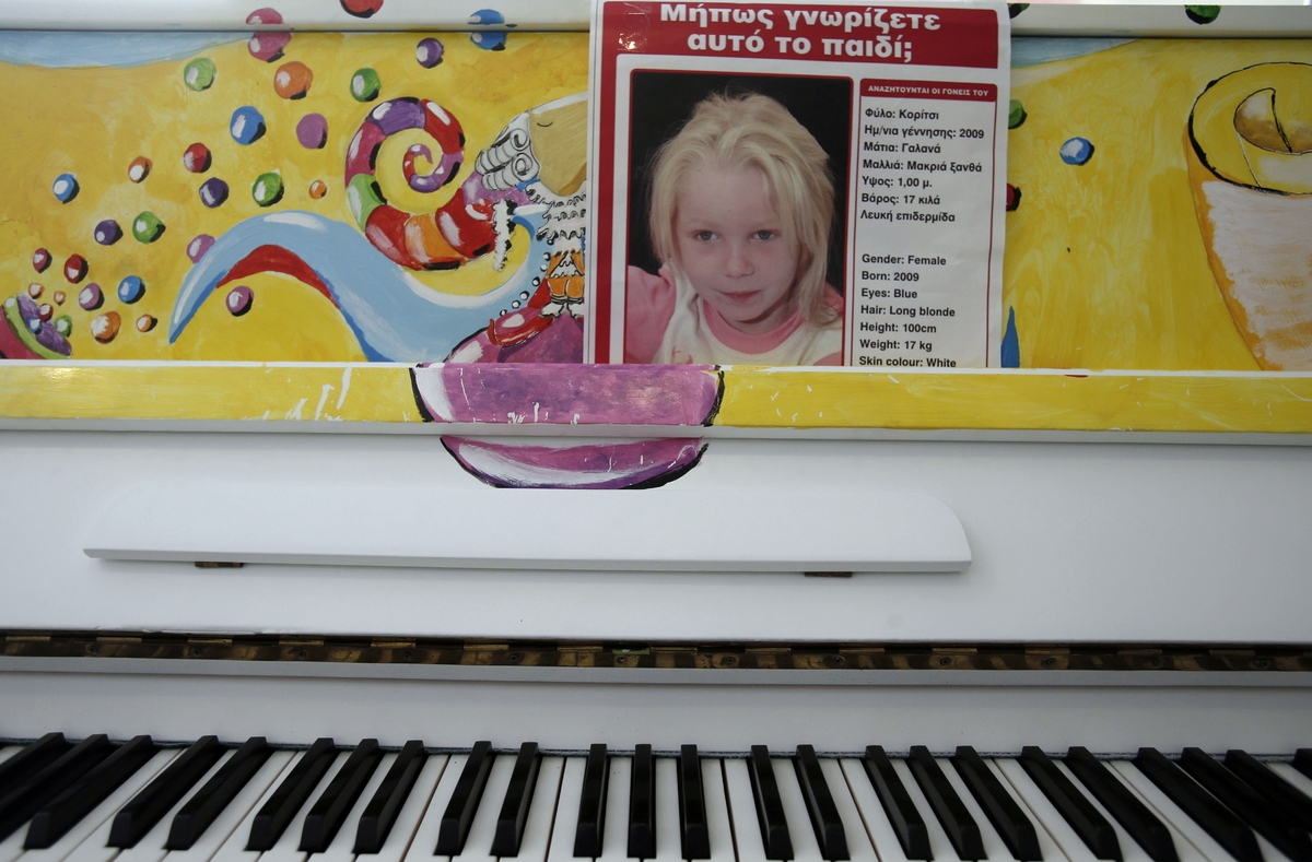 "A poster with the photo of the girl known as ''Maria'' and the words ""Do you know this girl?'' is displayed on a piano at the"