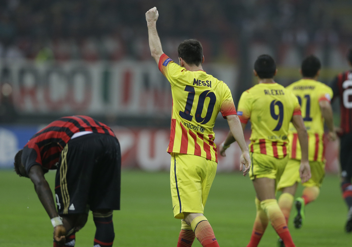 Barcelona's Lionel Messi celebrates after scoring a goal during a Champions League, Group H, soccer match between AC Milan an