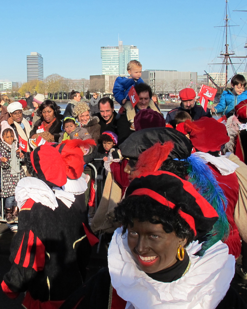 """In this Nov. 18, 2012 photo persons dressed as """"Zwarte Piet"""" or """"Black Pete"""" attend a parade after St. Nicholas, or Sinterkla"""