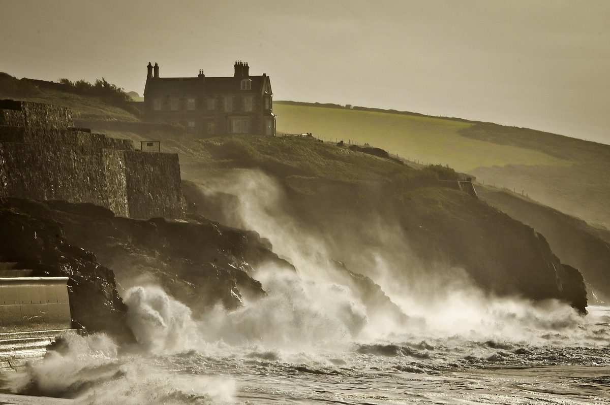 Waves crash onto the cliffs surrounding Porthleven, Cornwall, southwest England, Sunday, Oct. 27, 2013. Forecasters say a sev