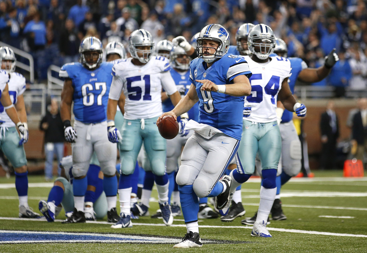 Detroit Lions quarterback Matthew Stafford (9) celebrates scoring on a 1-yard touchdown run against the Dallas Cowboys in the
