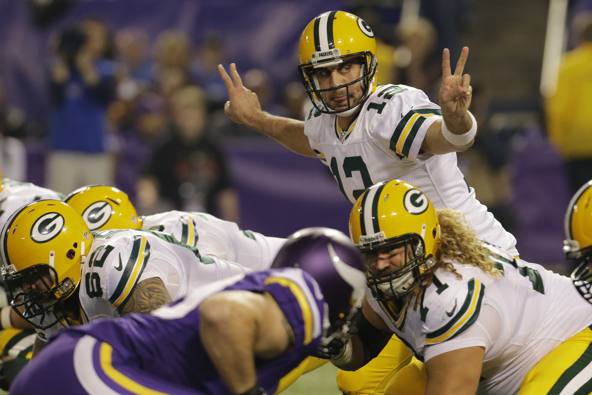 Green Bay Packers quarterback Aaron Rodgers (12) calls a play in the first half of an NFL football game against the Minnesota