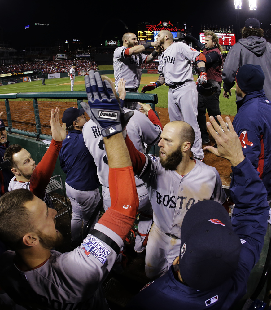 Boston Red Sox Mike Napoli, upper left, pulls Jonny Gomes' beard after Gomes hit a three run home run off of St. Louis Cardin