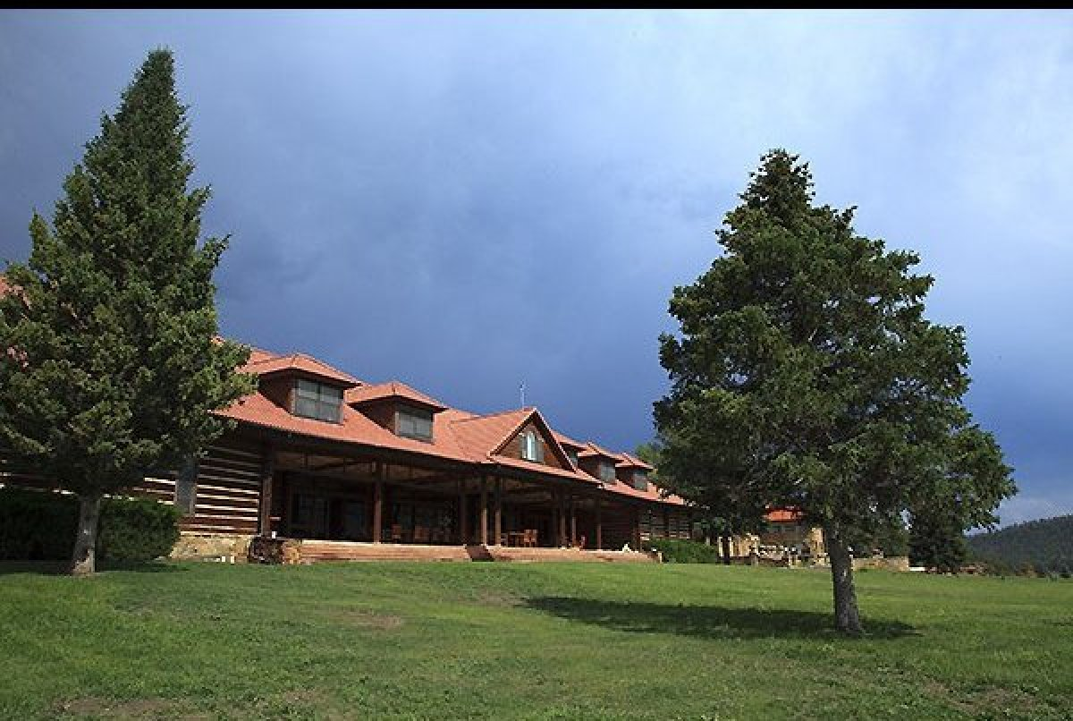 The comfortable but rustic log cabin-style main lodge overlooks impressive scenery and serves award-winning meals, Vermejo Pa