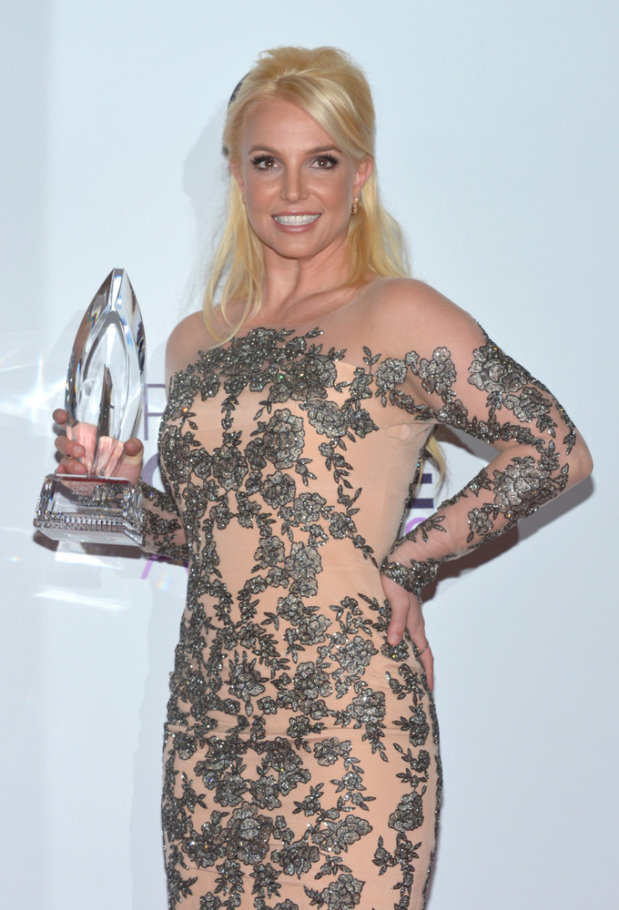 Britney Spears poses in the press room with her award for Favorite Pop Artist at the 40th annual People's Choice Awards at No