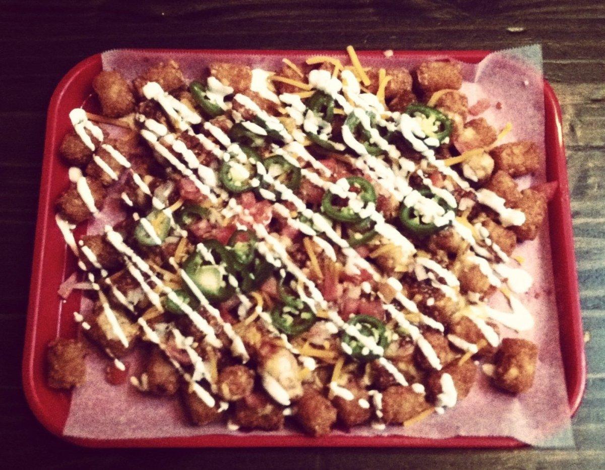 "<strong>See more <a href=""http://www.foodandwine.com/slideshows/outrageous-nachos#!slide=7"" target=""_hplink"">Outrageous Nacho"
