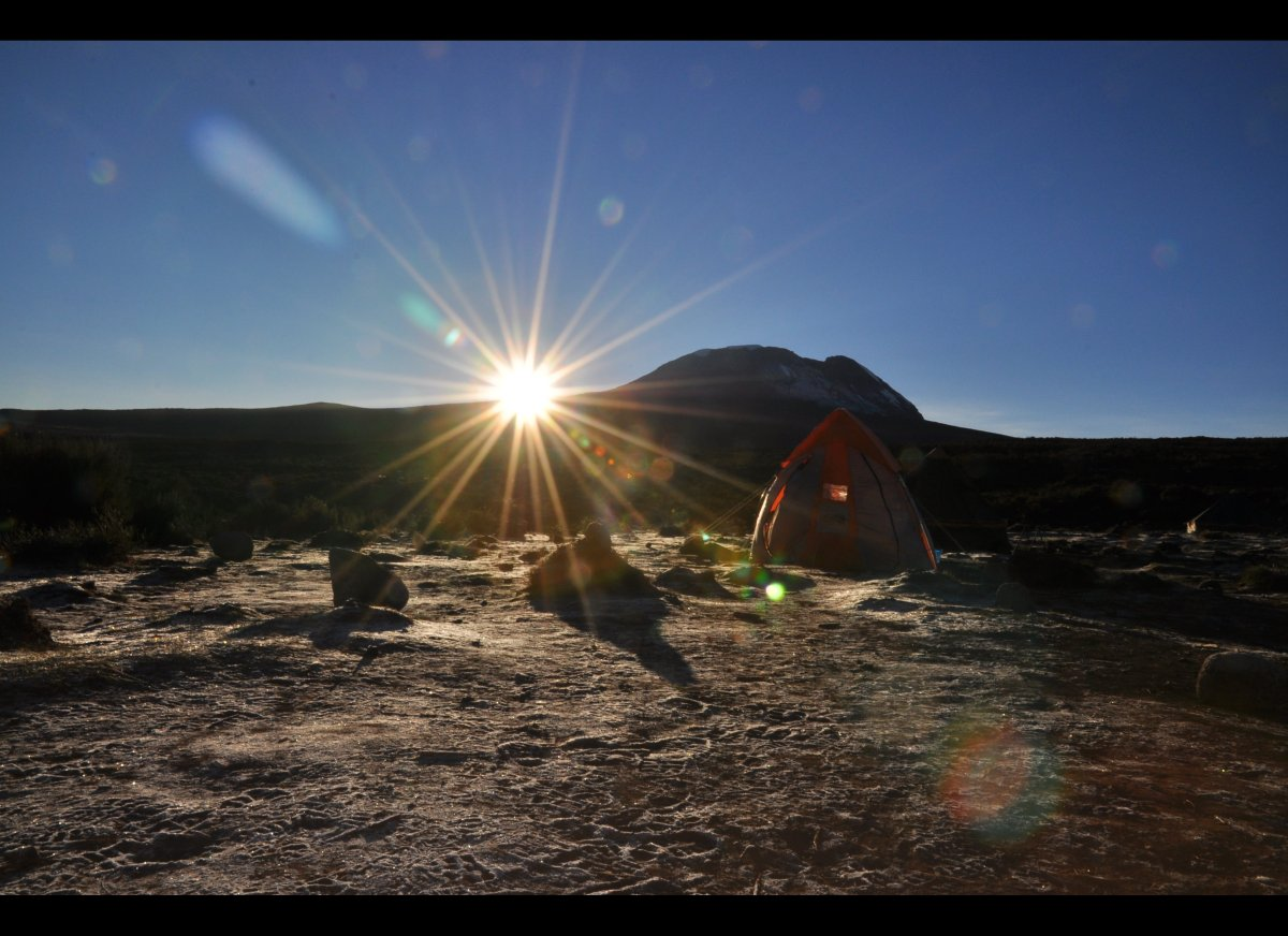 Poking my head out from the tent into the cold morning air to see the sun appear from behind Kilimanjaro – the warmth of the