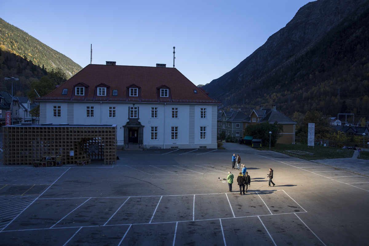 People gather on a spot in front of the town hall of Rjukan, Norway, Friday, Oct. 18, 2013, where sunshine is reflected by th