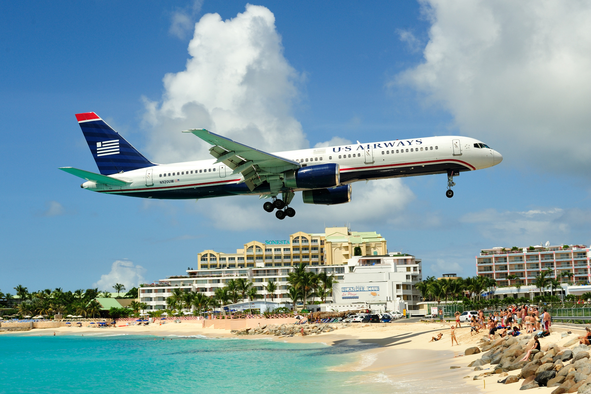 Incoming passengers land over ridiculously blue water and an expansive beach on their way to this Caribbean hub. But beach go