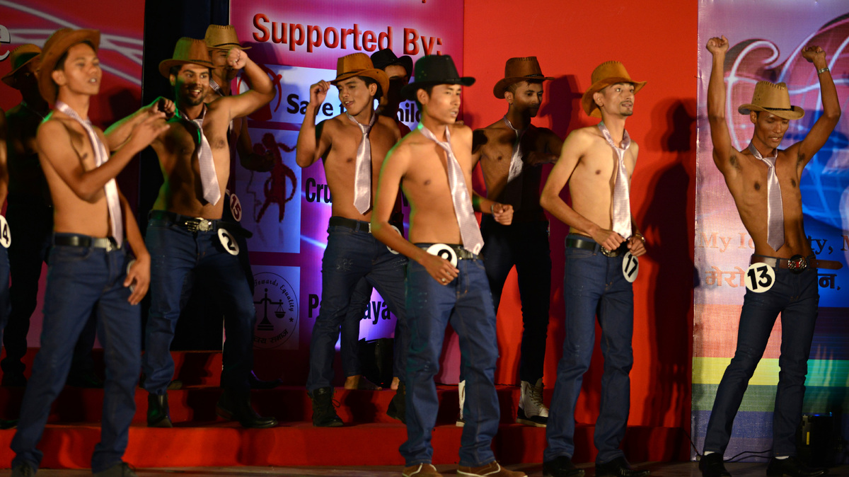 Shirtless participants in neckties are pictured onstage during the Mr. Handsome 2013 pageant for gays in Kathmandu on Novembe
