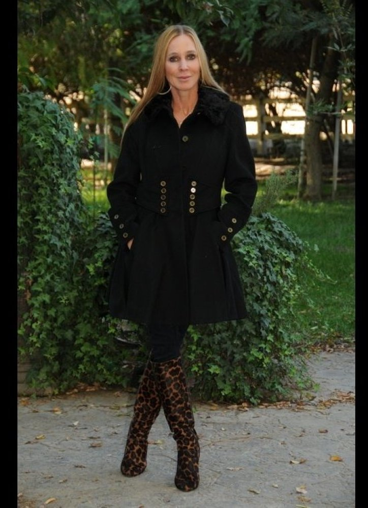 CEO and founder of Namaste Farms Natalie Redding models a Betsey Johnson ladylike dress coat design purchased at Macy's. Redd