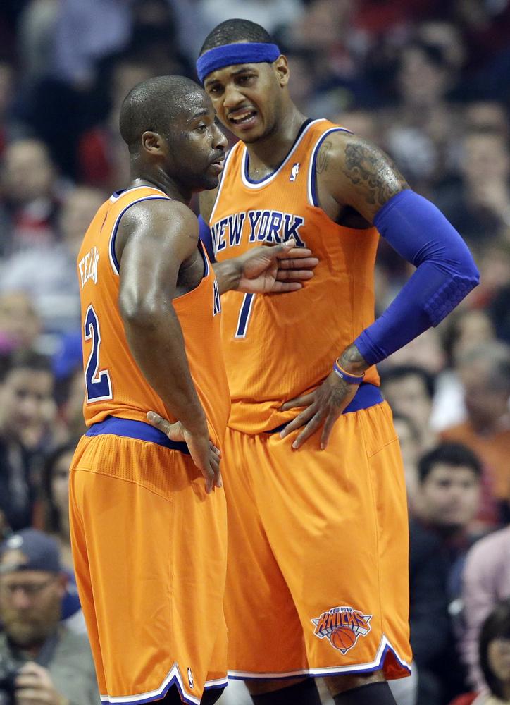 New York Knicks guard Raymond Felton, left, talks as forward Carmelo Anthony reacts during the first half of an NBA basketbal