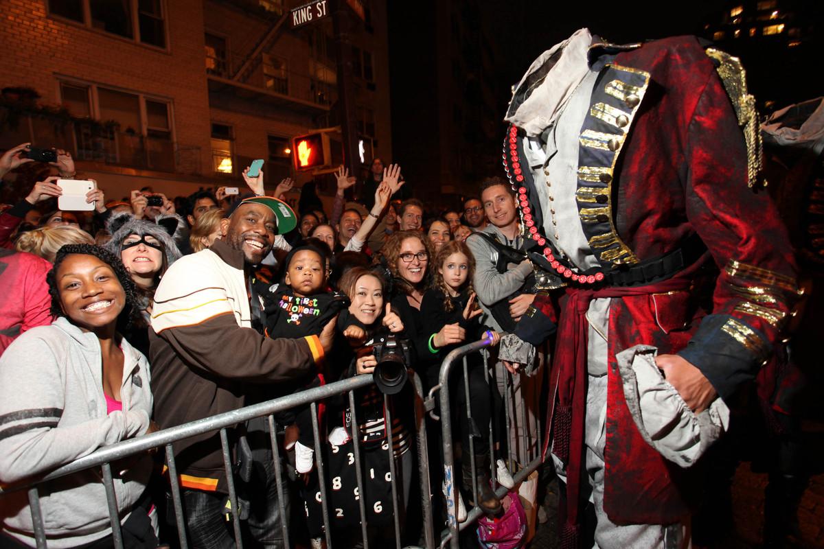 """The 7-foot-tall Headless Horseman greets fans during """"Sleepy Hollow-een Headless Horseman Stunt"""" at the Village Halloween Par"""
