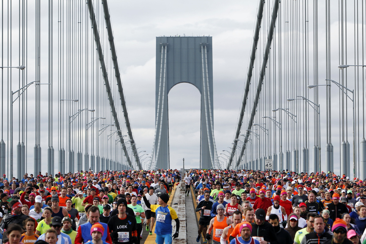 Runners cross the Verrazano-Narrows Bridge at the start of the New York City Marathon, Sunday, Nov. 3, 2013, in New York. (AP