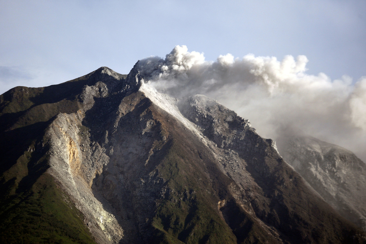Mount Sinabung spews volcanic materials from its crater as seen from Karo, North Sumatra, Indonesia, Monday, Sept. 16, 2013.