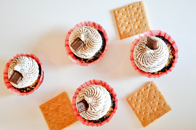 """<strong>Get the <a href=""""http://lemon-sugar.com/2011/10/this-is-of-two-smores-cupcake-posts.html/"""" target=""""_blank"""">S'mores Cu"""
