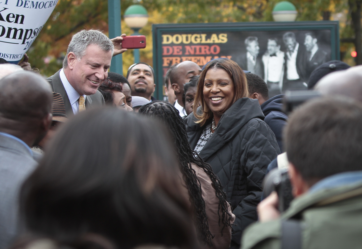 Democratic mayoral candidate Bill de Blasio, left, accompanied by Letitia James, center, candidate for Public Advocate, meet