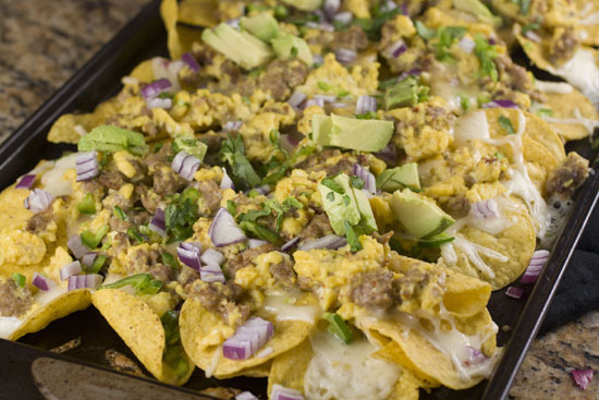 "<strong>Get the <a href=""http://www.macheesmo.com/2012/02/breakfast-nachos/"">Breakfast Nachos recipe from Macheesmo</a></stro"