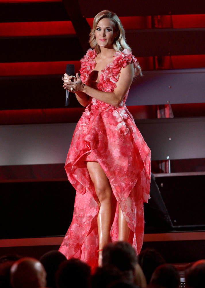 Host Carrie Underwood speaks on stage at the 47th annual CMA Awards at Bridgestone Arena on Wednesday, Nov. 6, 2013, in Nashv