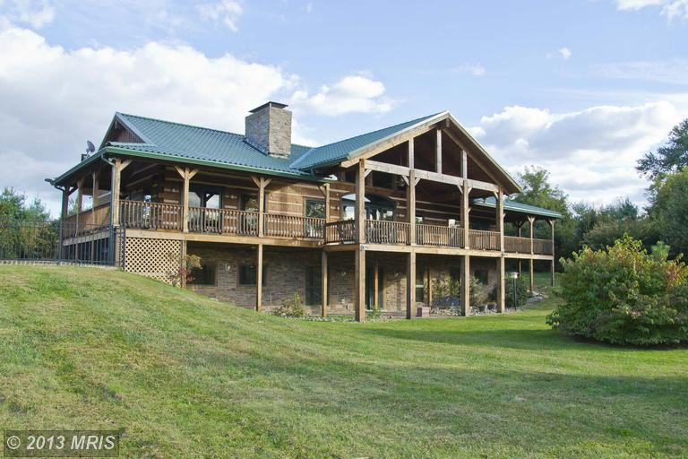 Five bedrooms, four baths on three acres in Northern Virginia. You don't even need to go fully rustic in this luxurious cabin