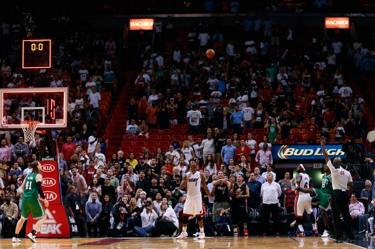 MIAMI, FL - NOVEMBER 09: Jeff Green #8 of the Boston Celtics watches his three point shot at the buzzer as Chris Bosh #1 of t