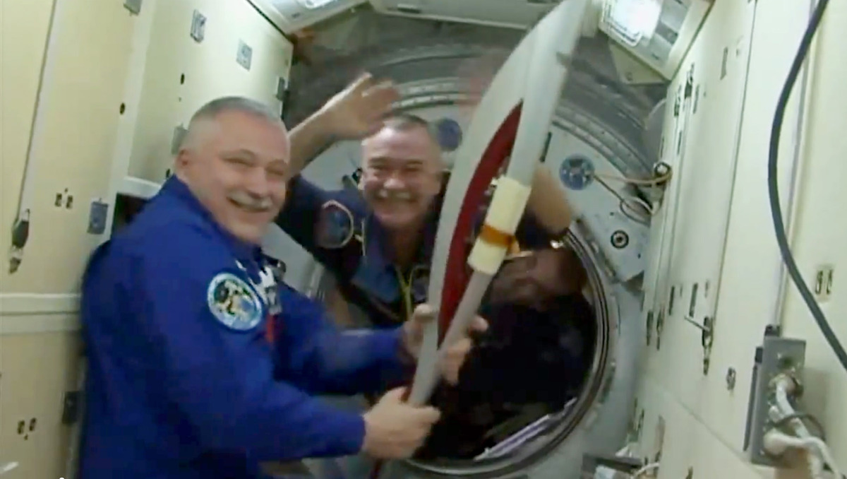 Cosmonaut Fyodor Yurchikhin, International Space Station commander, holds the Sochi 2014 Winter Olympics torch brought aboard