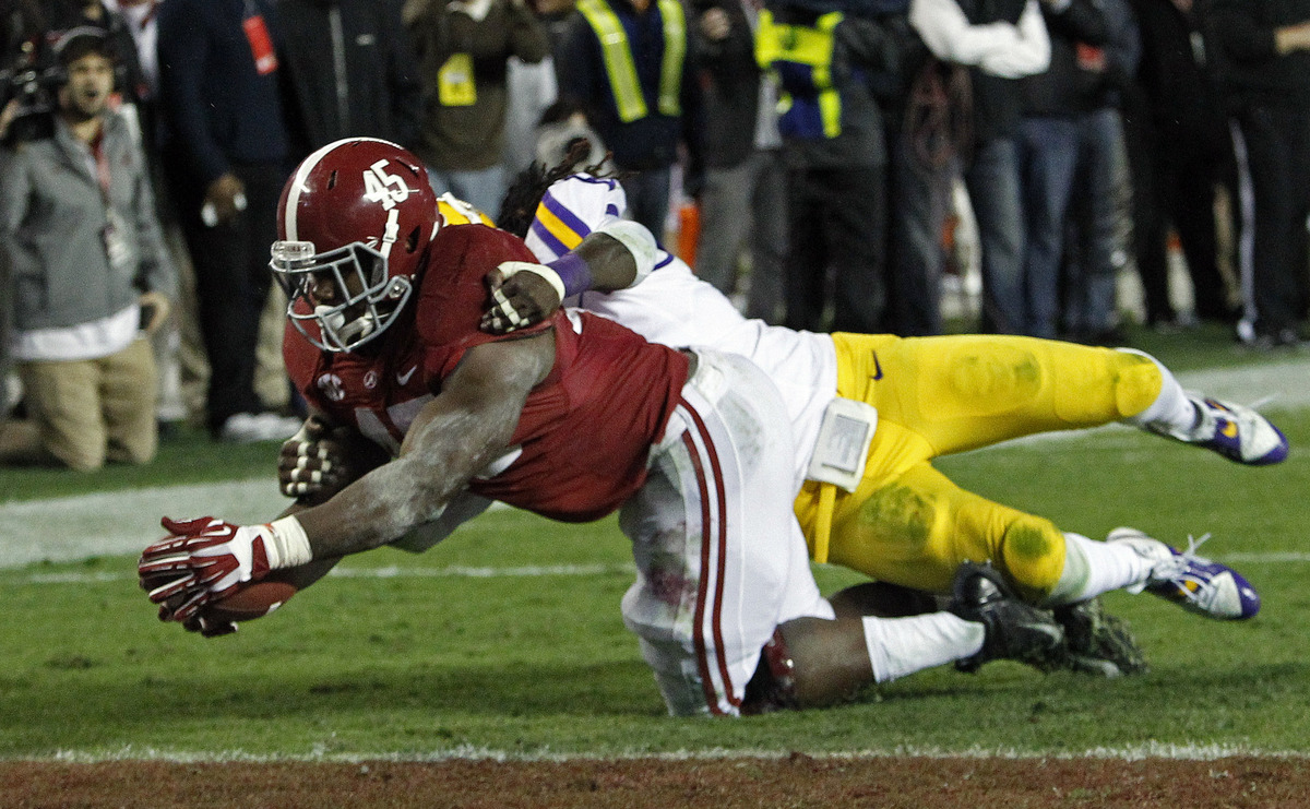 Alabama running back Jalston Fowler (45) runs into the end zone for a touchdown against LSU safety Craig Loston (6) during th
