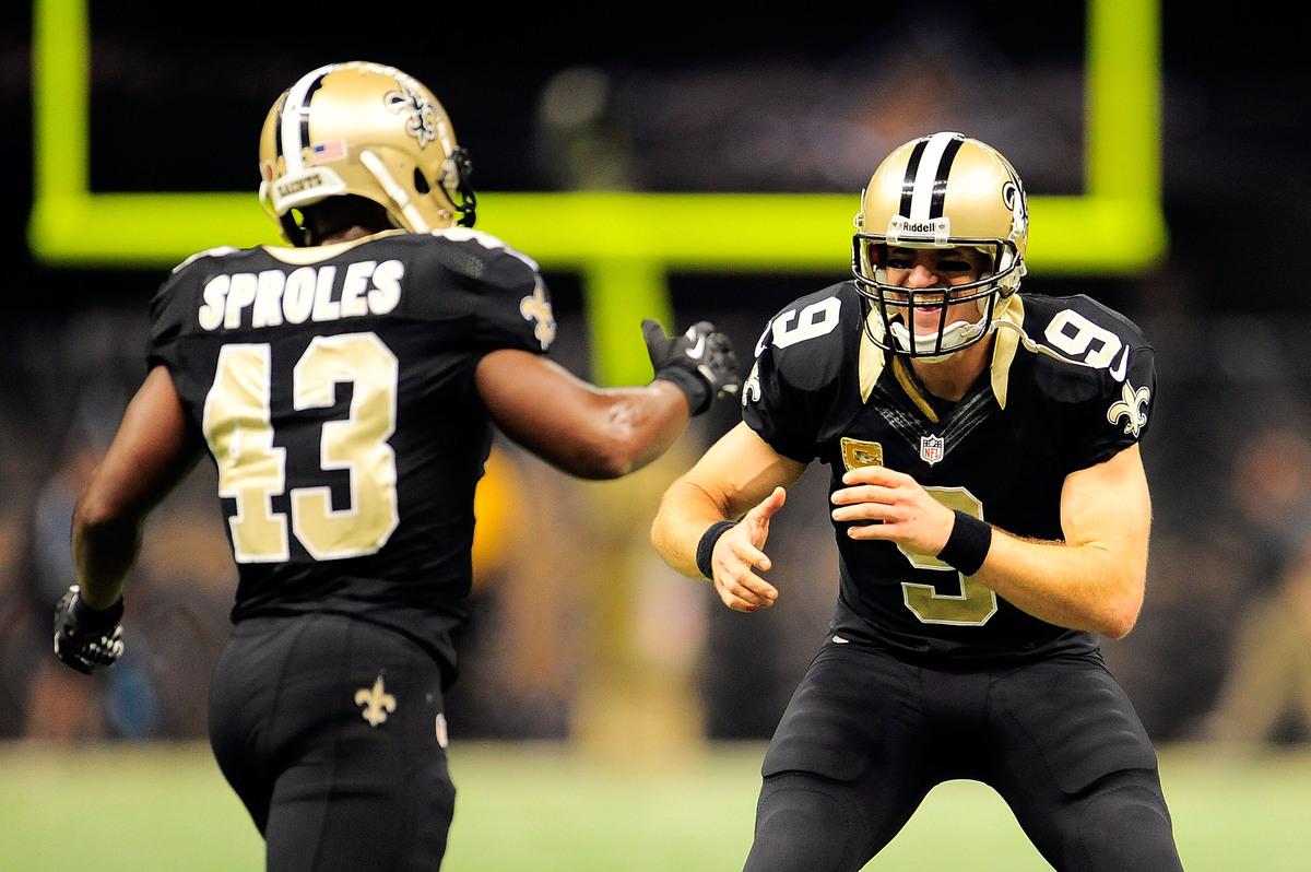 NEW ORLEANS, LA - NOVEMBER 10:  Drew Brees #9 of the New Orleans Saints congratulates Darren Sproles #43 following a touchdow